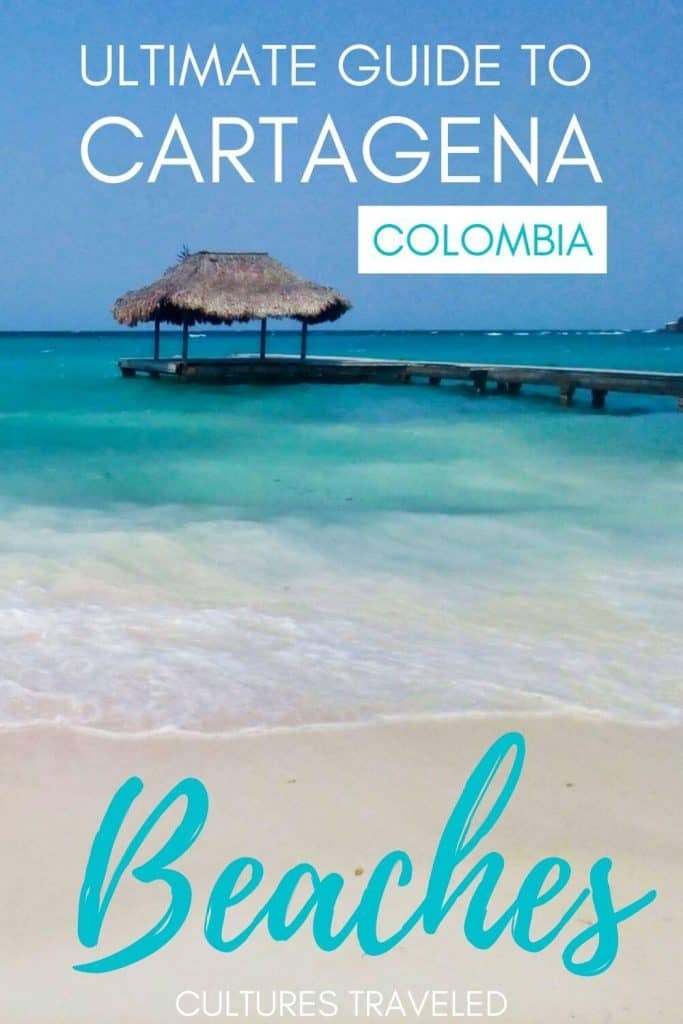 Image of turquoise ocean and sand with a long dock, with the words Ultimate Guide to Cartagena Colombia Beaches on top.