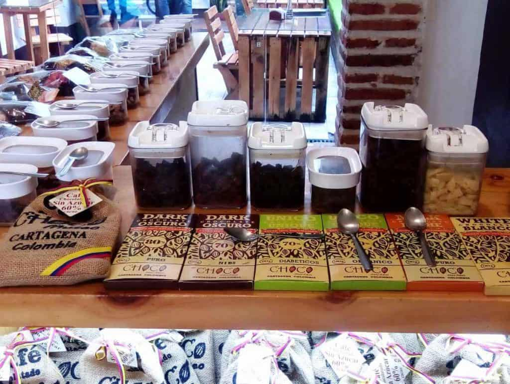 Containers filled with chocolate pieces line the counter for tasting at the Choco Museo in Cartagena.